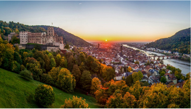 The Heidelberg Castle and the Old Town at sunset.